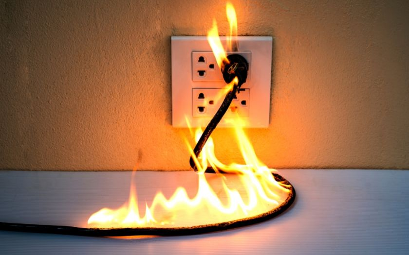 Avoid electrical fires through independent cable testing and compliance to industry standards | Shutterstock 1349684537 Plug On Fire Web