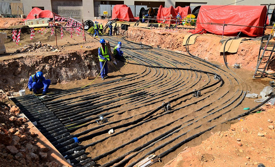 Labours Laying Cables for a Distribution Network in MENA