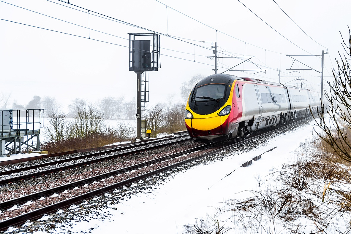 train-on-UK-railroad-in-snow.jpg