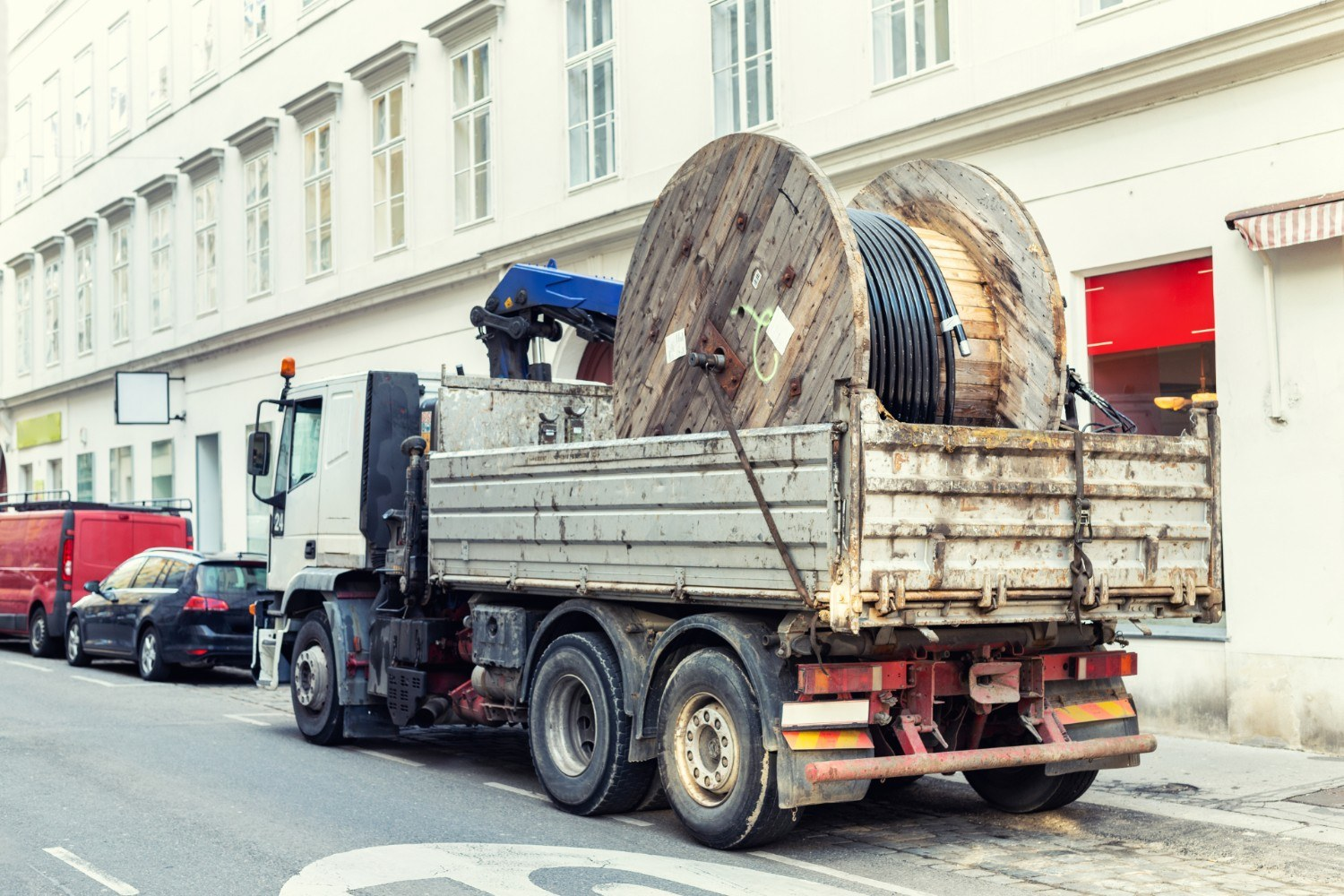 shutterstock_1410437237-lorry-delivering-electrical-cable-drum-to-construction-site_web.jpg