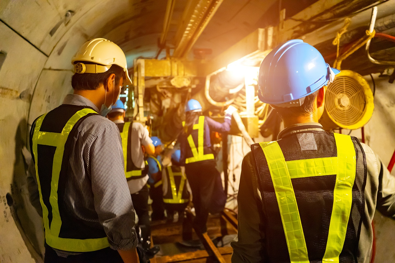 engineers-in-underground-tunnel-doing-maintenance.jpg