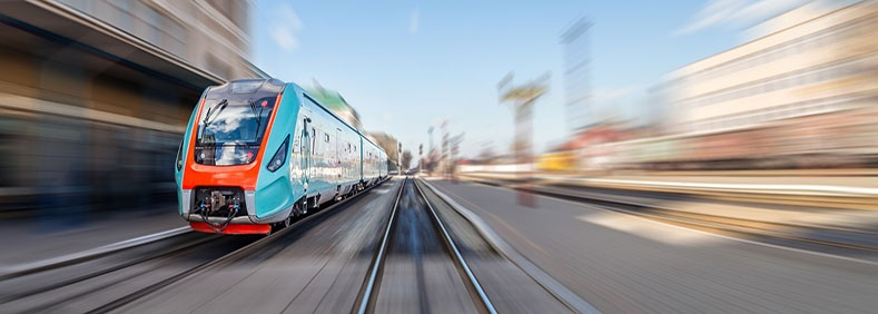 shutterstock_379006042-red-and-blue-train-at-platform-moving-blurred-background.jpg