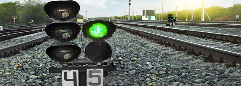 shutterstock_452453449-green-traffic-light-on-railway-track.jpg