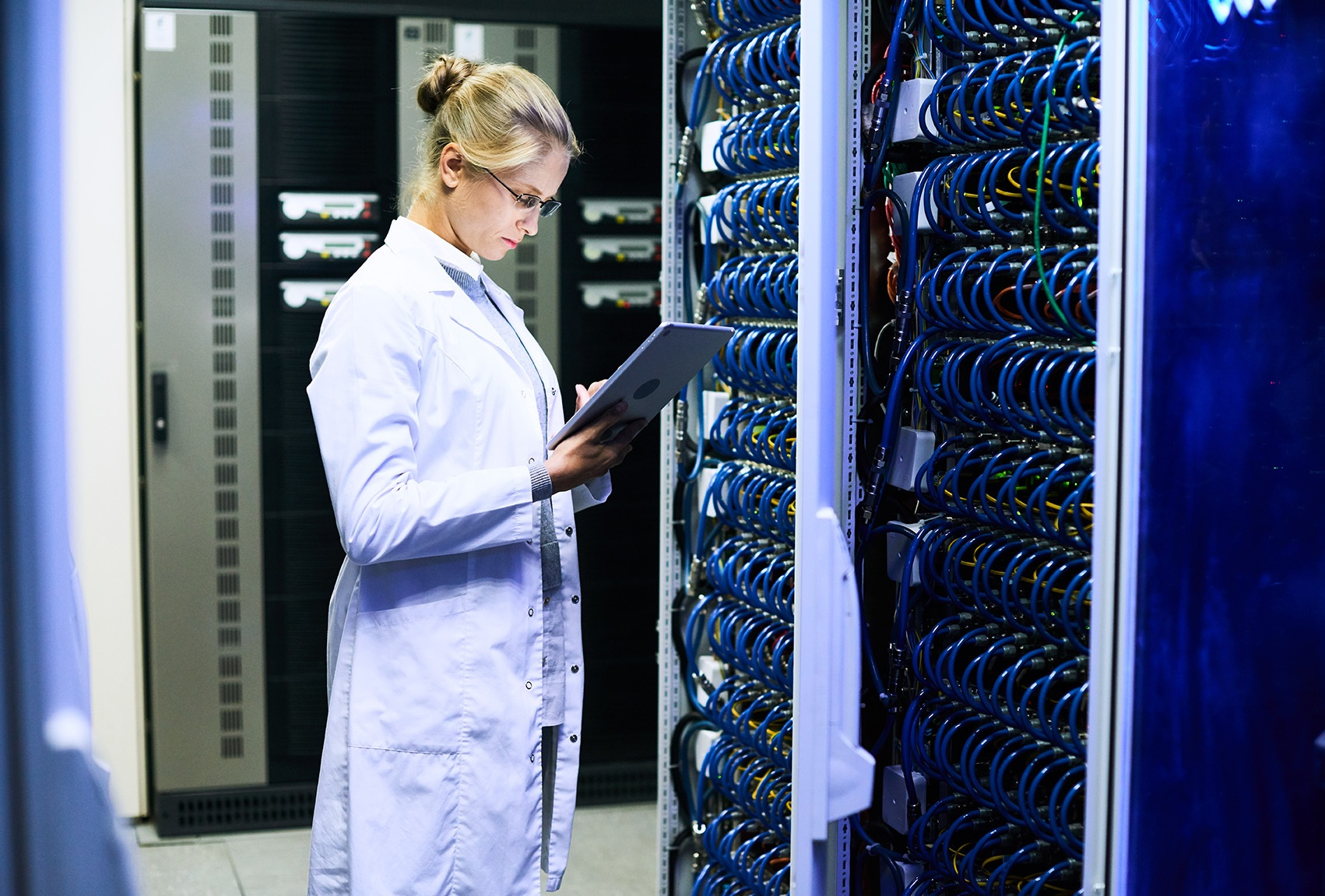 woman-in-lab-coat-working-in-data-centre.jpg
