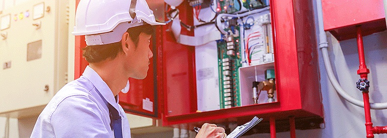 Engineer inspecting fire safety engineering systems